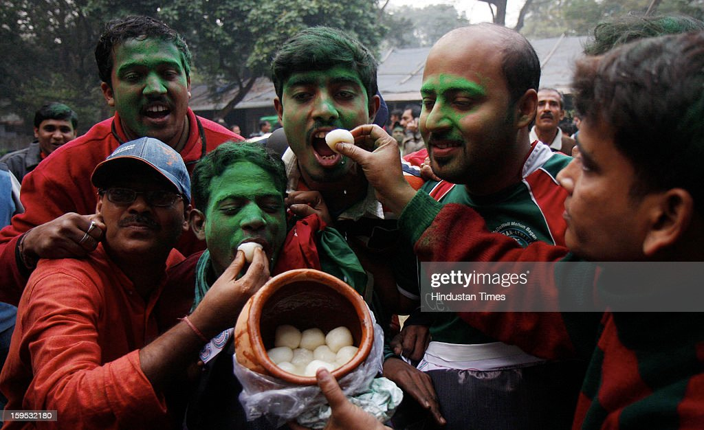 Mohun Bagan club supporters celebrate after AIFF withdraw a two-year ban on the club, on January 15, 2013 in Kolkata, India. The club was banned from the ongoing league and the next two editions for declining to take the field after half-time against East Bengal on December 9 because one of their players was injured by a stone thrown from the crowd.