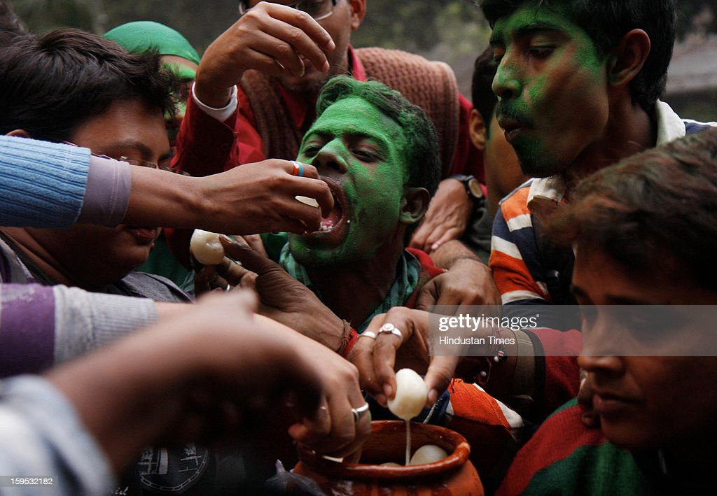Mohun Bagan club supporters celebrate after AIFF withdraws a two-year ban on the club, on January 15, 2013 in Kolkata, India. The club was banned from the ongoing league and the next two editions for declining to take the field after half-time against East Bengal on December 9 because one of their players was injured by a stone thrown from the crowd.