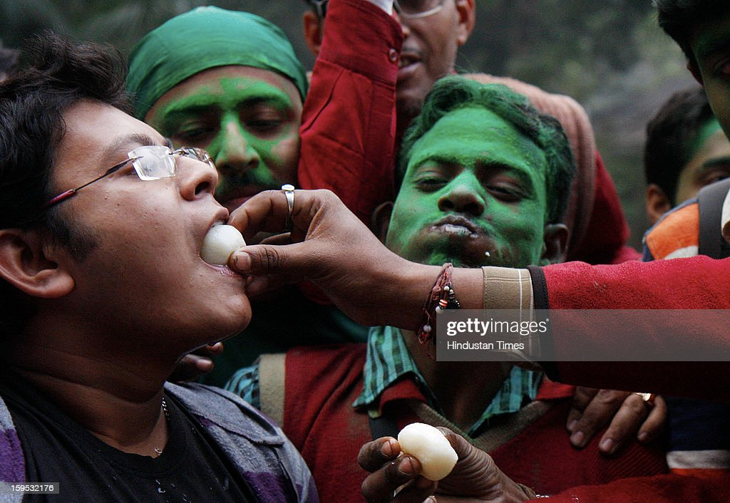 Mohun Bagan club supporters celebrate after AIFF withdraws a two-years ban on the club, on January 15, 2013 in Kolkata, India. The club was banned from the ongoing league and the next two editions for declining to take the field after half-time against East Bengal on December 9 because one of their players was injured by a stone thrown from the crowd.