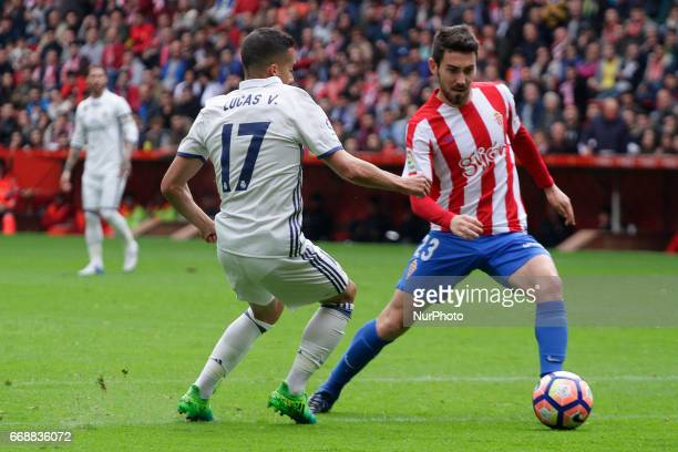 Moi Gomez midfielder of Sporting de Gijon battles for the ball with Lucas Vazquez forward of Real Madrid during the La Liga Santander match between...