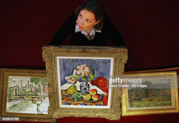Moira Gow of auction house Lyon Turnbull holds up Still Life with Lilies and Fruit one of three paintings by Scottish colourist Leslie Hunter worth...