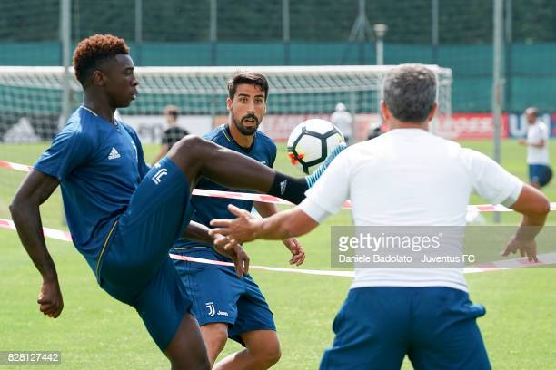 Moise Bioty Kean and Sami Khedira of Juventus during a training session on August 9 2017 in Vinovo Italy