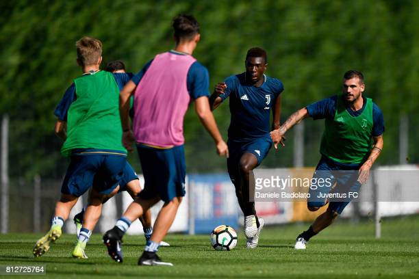 Moise Bioty Kean and Stefano Sturaro of Juventus during the afternoon training session on July 11 2017 in Vinovo Italy