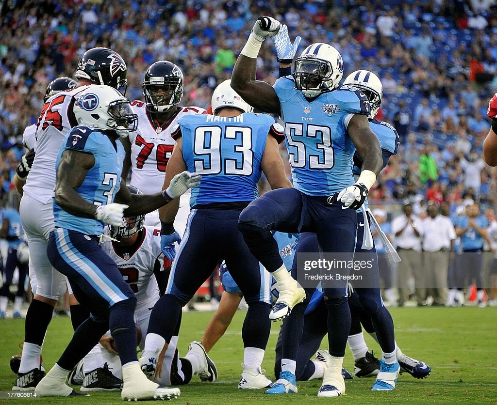 Moise Fokou #53 of the Tennessee Titans celebrates after a sack of quarterback Matt Bryant #3 of the Atlanta Falcons at LP Field on August 24, 2013 in Nashville, Tennessee.