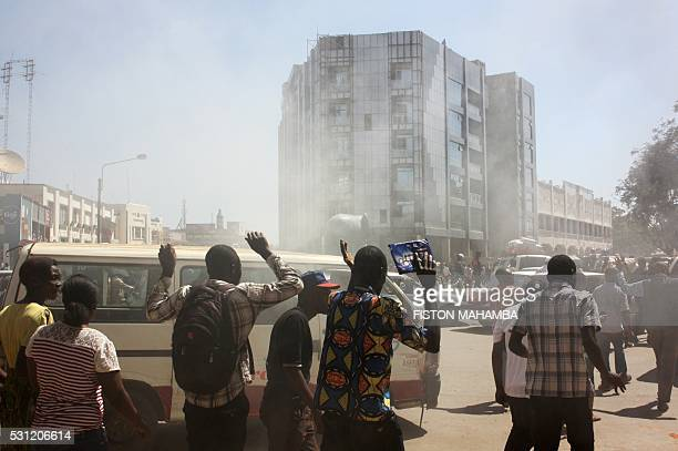 Moise Katumbi supporters disperse after police fired tear gas outside the courthouse in Lubumbashi on May 13 2016 Police in DR Congo fired tear gas...