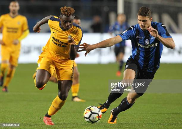 Moise Kean of Hellas Verona FC competes for the ball with Mattia Caldara of Atalanta BC during the Serie A match between Atalanta BC and Hellas...