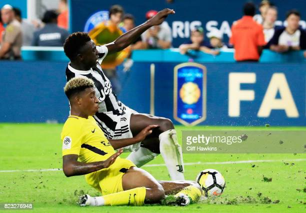 Moise Kean of Juventus and Presnel Kimpembe of Paris SaintGermain vie for possession in the second half during their International Champions Cup 2017...