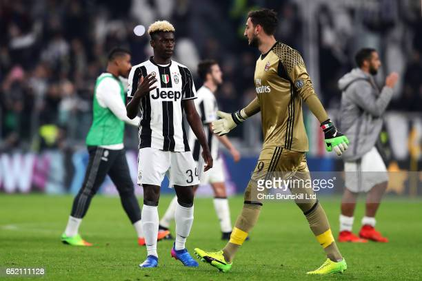 Moise Kean of Juventus FC offers his hand to Gianluigi Donnarumma of AC Milan at fulltime following the Serie A match between Juventus FC and AC...
