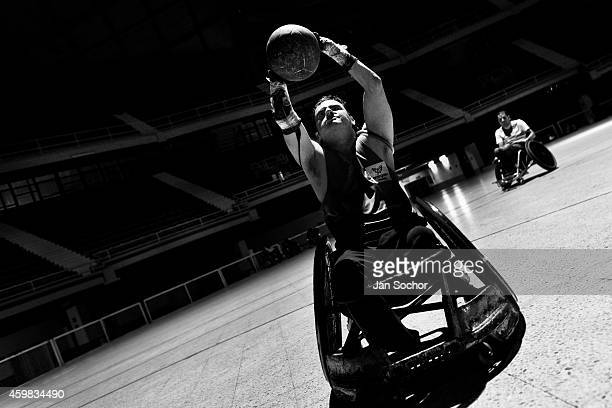 Moises Alonso a Colombian disabled athlete holds the ball during a wheelchair rugby training match at the indoor sporting arena Coliseo on January 29...