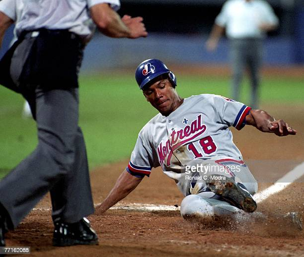 Moises Alou of the Montreal Expos scores during a MLB game against the Atlanta Braves on July 25 1994 in Atlanta Georgia
