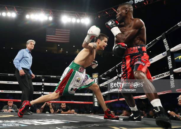Moises Flores fires a right to Guillermo Rigondeaux during their super bantamweight championship bout at the Mandalay Bay Events Center on June 17...