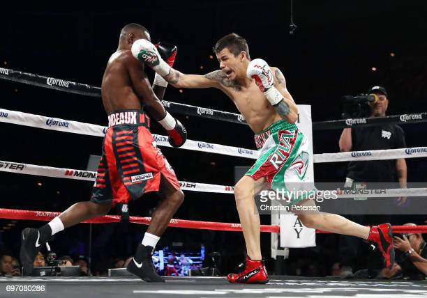 Moises Flores punches at Guillermo Rigondeaux during their super bantamweight championship bout at the Mandalay Bay Events Center on June 17 2017 in...