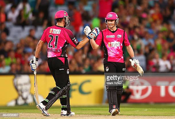 Moises Henriques and Nic Maddinson of the Sixers celebrate winning the Big Bash League match between Sydney Thunder and the Sydney Sixers at ANZ...