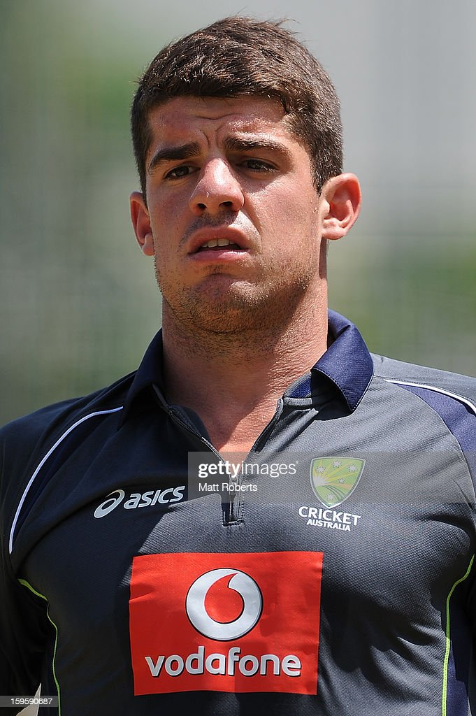 <a gi-track='captionPersonalityLinkClicked' href=/galleries/search?phrase=Moises+Henriques&family=editorial&specificpeople=875812 ng-click='$event.stopPropagation()'>Moises Henriques</a> looks on during an Australian training session at The Gabba on January 17, 2013 in Brisbane, Australia.