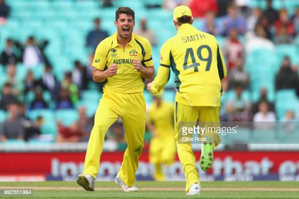 Moises Henriques of Australia celebrates the wicket of Mushfiqur Rahim of Bangladesh during the ICC Champions trophy cricket match between Australia...