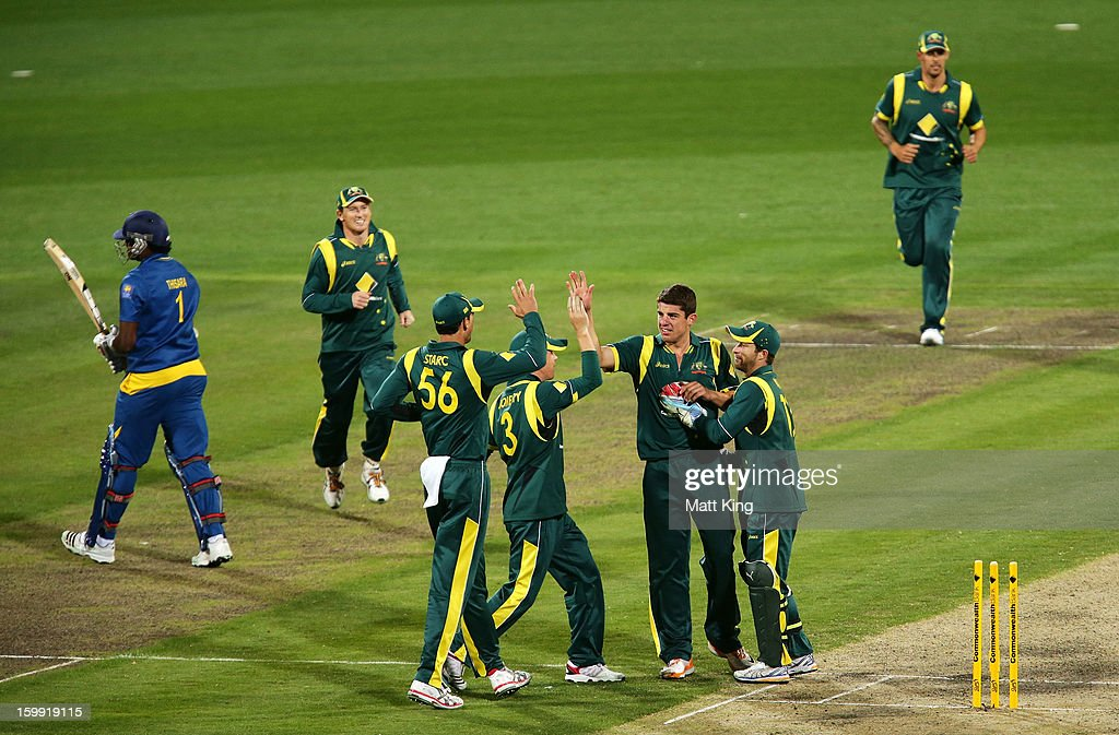 <a gi-track='captionPersonalityLinkClicked' href=/galleries/search?phrase=Moises+Henriques&family=editorial&specificpeople=875812 ng-click='$event.stopPropagation()'>Moises Henriques</a> (C) of Australia celebrates with team mates after taking the wicket of Thisara Perera of Sri Lanka during game five of the Commonwealth Bank One Day International series between Australia and Sri Lanka at Blundstone Arena on January 23, 2013 in Hobart, Australia.