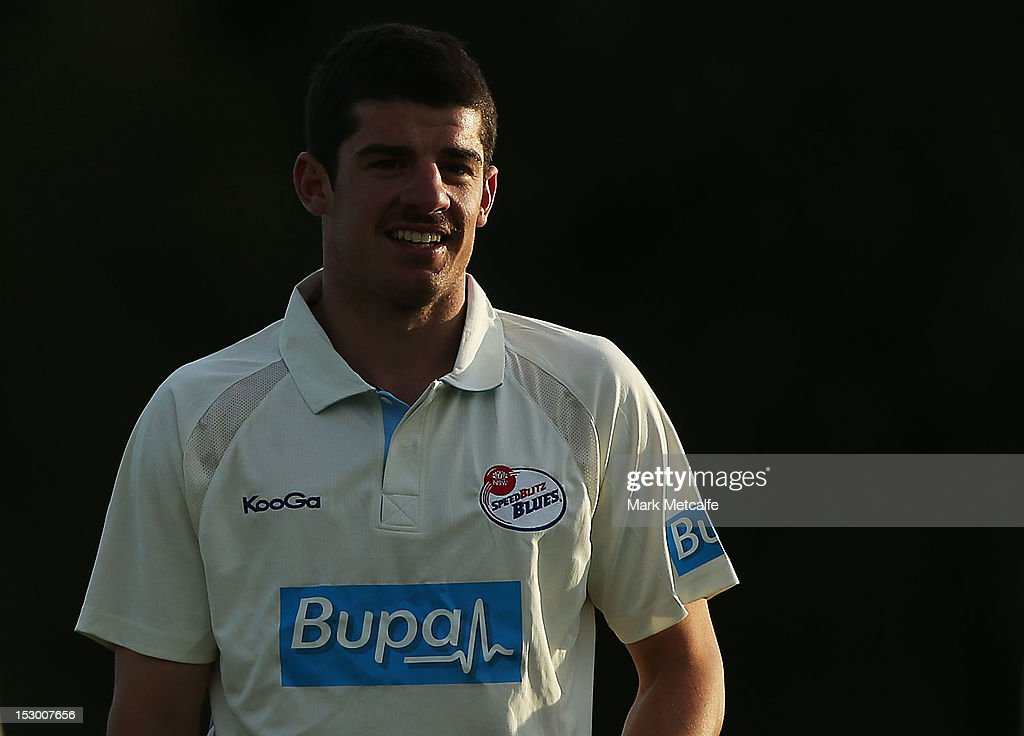 <a gi-track='captionPersonalityLinkClicked' href=/galleries/search?phrase=Moises+Henriques&family=editorial&specificpeople=875812 ng-click='$event.stopPropagation()'>Moises Henriques</a> of New South Wales smiles during during day four of the Sheffield Shield match between the New South Wales Blues and the Tasmanian Tigers at Bankstown Oval on September 29, 2012 in Sydney, Australia.