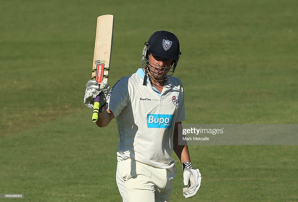 Moises Henriques of the Blues acknowledges the crowd after scoring a half century during day two of the Sheffield Shield match between the New South Wales Blues and the Western Australia Warriors at Blacktown International Sportspark on January 25, 2013 in Sydney, Australia.