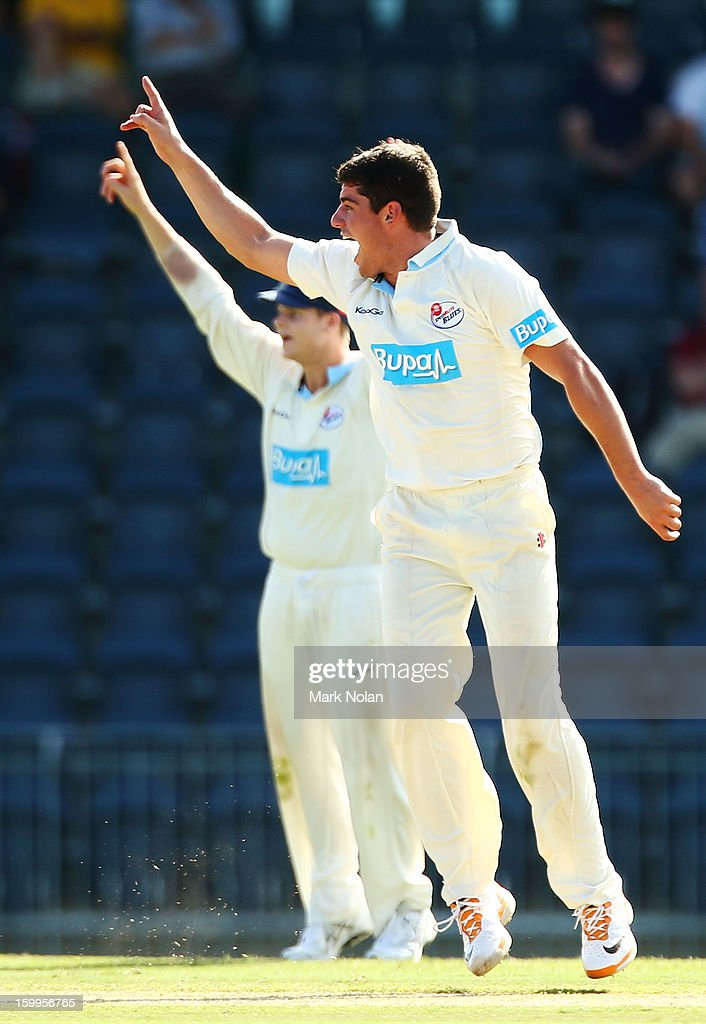 <a gi-track='captionPersonalityLinkClicked' href=/galleries/search?phrase=Moises+Henriques&family=editorial&specificpeople=875812 ng-click='$event.stopPropagation()'>Moises Henriques</a> of the Blues appeals for the wicket of Nathan Coulter-Nile of the Warriors during day one of the Sheffield Shield match between the New South Wales Blues and the Western Australia Warriors at Blacktown International Sportspark on January 24, 2013 in Sydney, Australia.