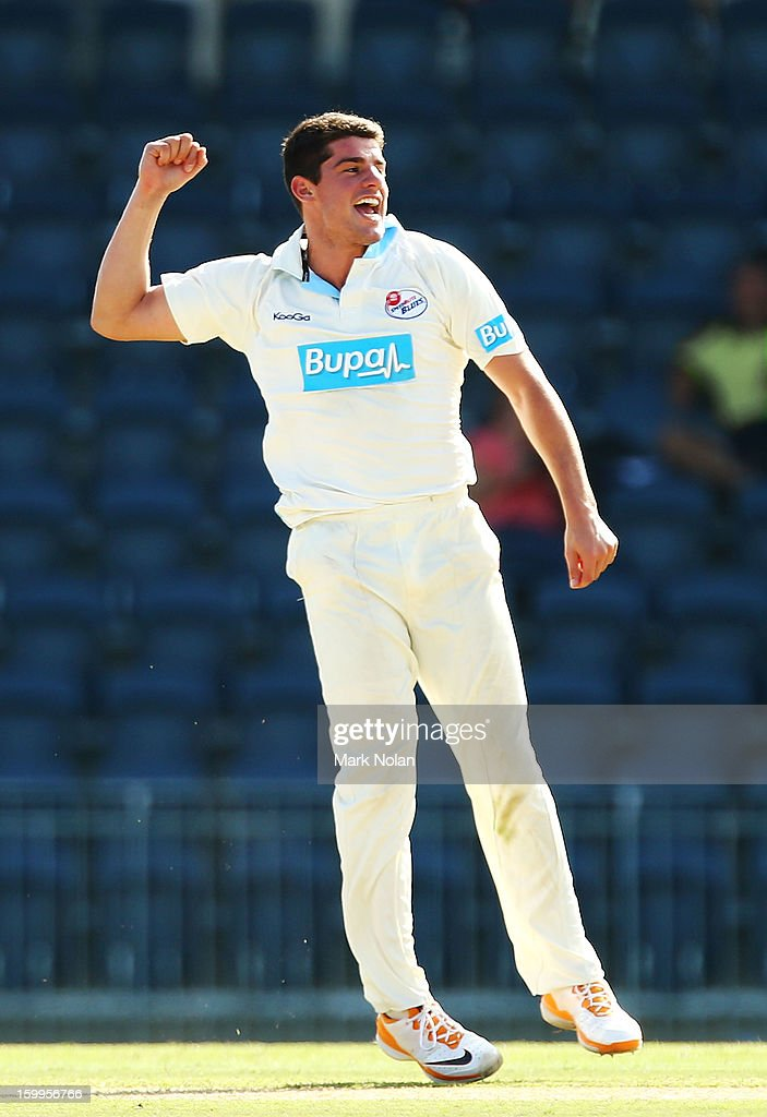 <a gi-track='captionPersonalityLinkClicked' href=/galleries/search?phrase=Moises+Henriques&family=editorial&specificpeople=875812 ng-click='$event.stopPropagation()'>Moises Henriques</a> of the Blues celebrates getting the wicket of Nathan Coulter-Nile of the Warriors during day one of the Sheffield Shield match between the New South Wales Blues and the Western Australia Warriors at Blacktown International Sportspark on January 24, 2013 in Sydney, Australia.