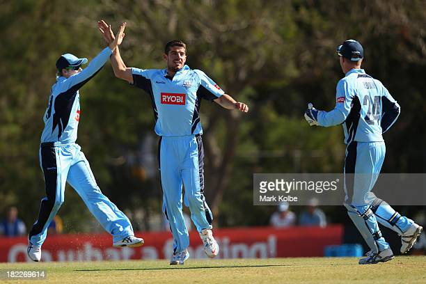 Moises Henriques of the Blues celebrates taking the wicket of Ed Cowan of the Tigers during the Ryobi Cup match between the New South Wales Blues and...