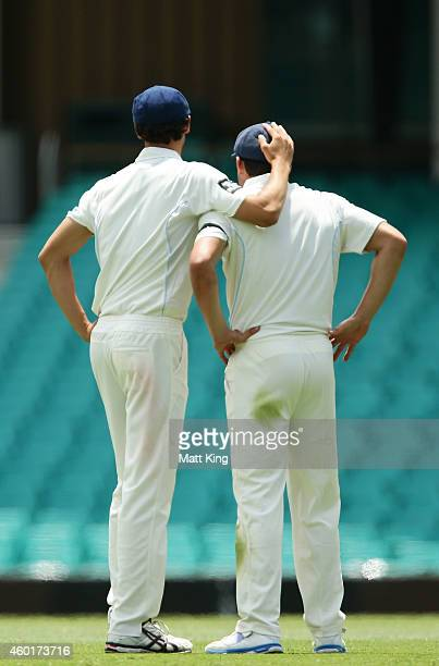 Moises Henriques of the Blues is embraced by Mitchell Starc after he took the wicket of Usman Khawaja of the Bulls during day one of the Sheffield...