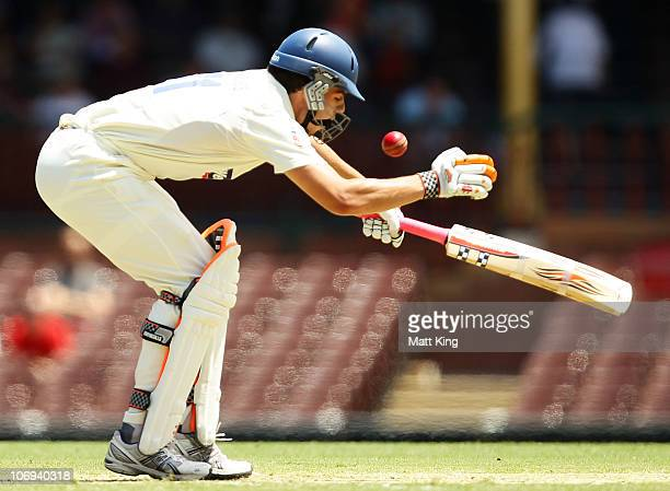 Moises Henriques of the Blues is hit by James Faulkner of the Tigers during day two of the Sheffield Shield match between the New South Wales Blues...