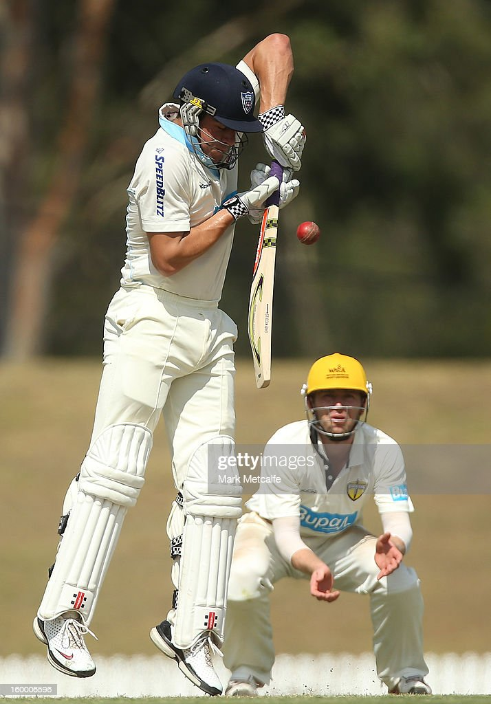 Moises Henriques of the Blues is struck on the hand off a delivery by Nathan Coulter-Nile of the Warriors during day two of the Sheffield Shield match between the New South Wales Blues and the Western Australia Warriors at Blacktown International Sportspark on January 25, 2013 in Sydney, Australia.