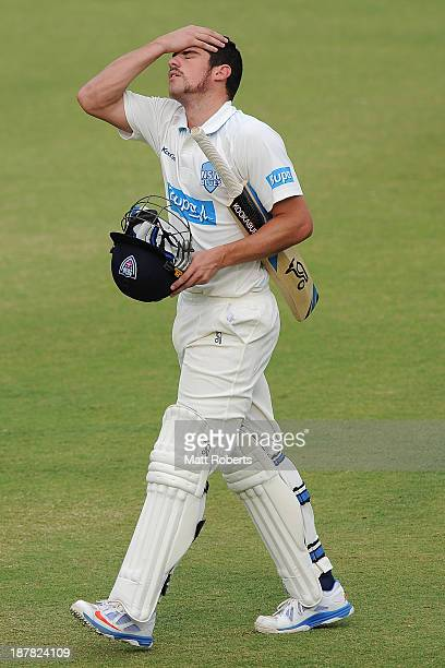 Moises Henriques of the Blues looks dejected as he leaves the field after being dismissed during day one of the Sheffield Shield match between the...