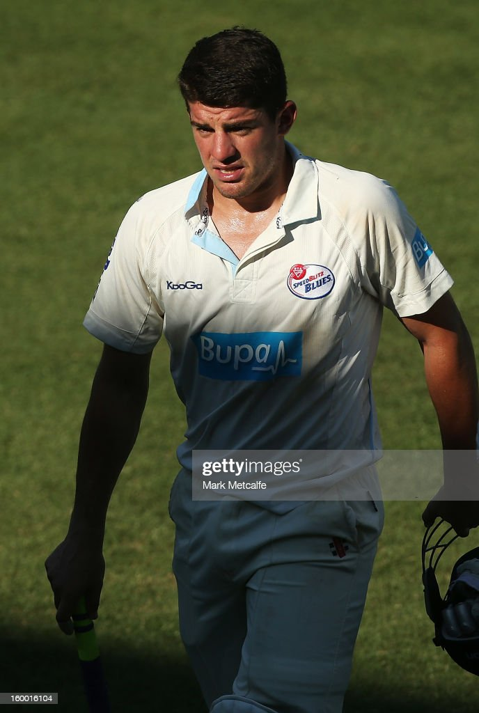 <a gi-track='captionPersonalityLinkClicked' href=/galleries/search?phrase=Moises+Henriques&family=editorial&specificpeople=875812 ng-click='$event.stopPropagation()'>Moises Henriques</a> of the Blues walks from the field at the end of play during day two of the Sheffield Shield match between the New South Wales Blues and the Western Australia Warriors at Blacktown International Sportspark on January 25, 2013 in Sydney, Australia.