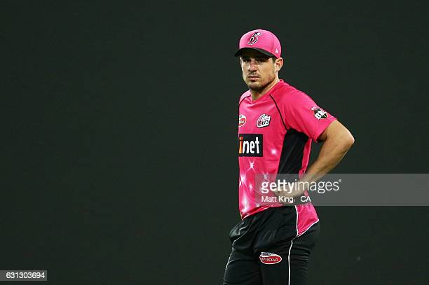 Moises Henriques of the Sixers looks on during the Big Bash League match between the Sydney Sixers and the Melbourne Renegades at Sydney Cricket...