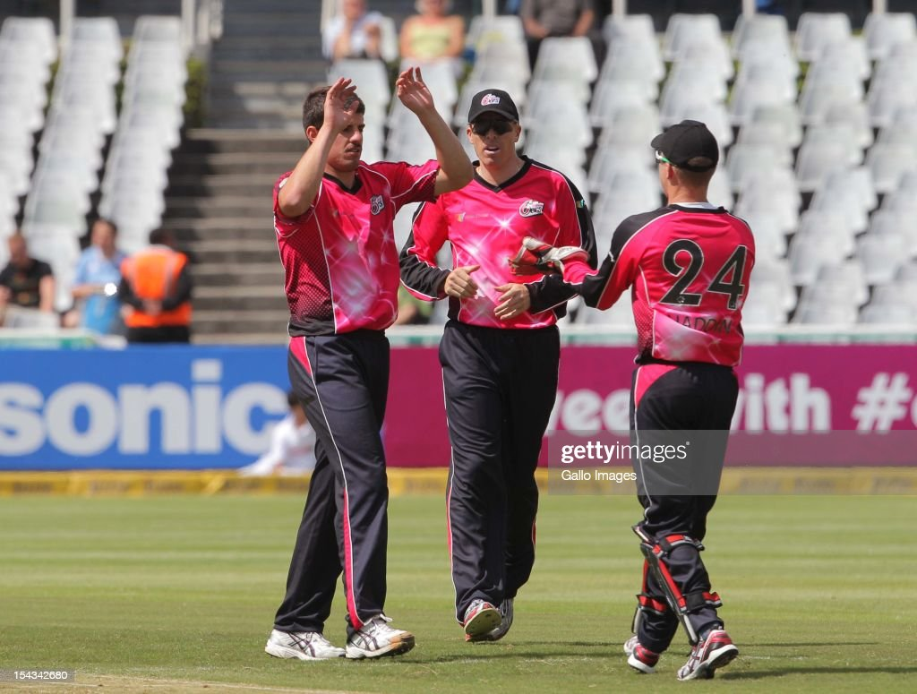 <a gi-track='captionPersonalityLinkClicked' href=/galleries/search?phrase=Moises+Henriques&family=editorial&specificpeople=875812 ng-click='$event.stopPropagation()'>Moises Henriques</a> of the Sydney Sixers celebrates a wicket during the Karbonn Smart CLT20 match between bizbub Highveld Lions (South Africa) and Sydney Sixers (Australia) at Sahara Park Newlands on October 18, 2012 in Cape Town, South Africa.