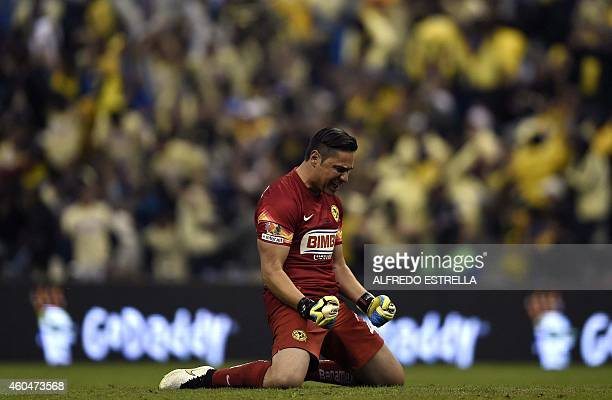 Moises Munoz goalkeeper of America celebrates a goal of the team against Tigres during their Mexican Clausura 2014 tournament final football match at...