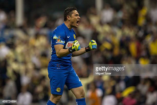 Moises Mu–noz of America celebrates a scored goal by Paolo Goltz of America during a quarterfinal second leg match between America and Pumas UNAM as...