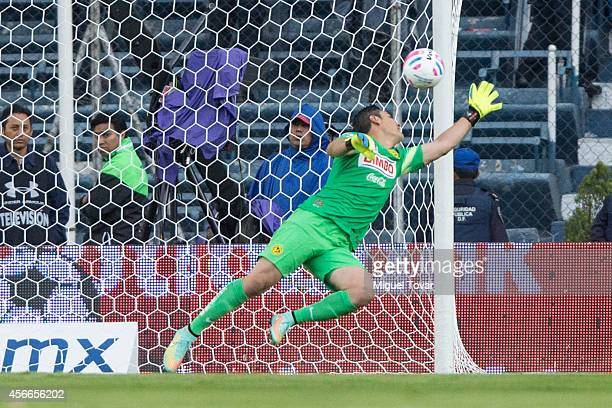 Moises Munoz of America receives a goal during a match between America and Cruz Azul as part of 12th round Apertura 2014 Liga MX at Azul Stadium on...