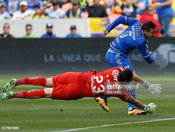 Moises Munoz of Club America makes a save on a shot attempt by Fernando Fernandez of Tigres UANL at BBVA Compass Stadium on March 26 2016 in Houston...