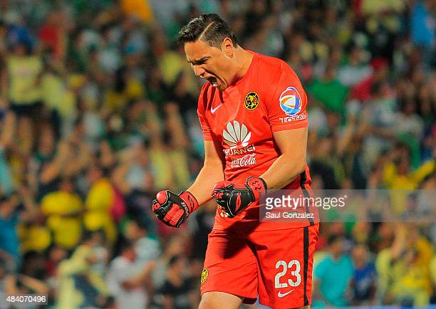 Moises Muñoz goalkeeper of America celebrates the first goal of his team scored by Dario Benedetto during a 5th round match between Santos Laguna and...