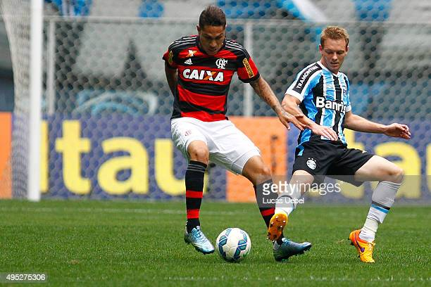 Moises of Gremio battles for the ball against Paolo Guerrero of Flamengo during the match Gremio v Flamengo as part of Brasileirao Series A 2015 at...