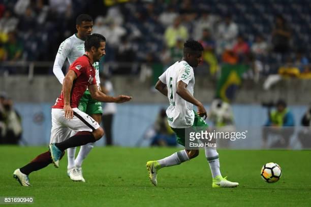 Moises Ribeiro of Chapecoense controls the ball under pressure of Zlatan Ljubijankic of Urawa Red Diamonds during the Suruga Bank Championship match...
