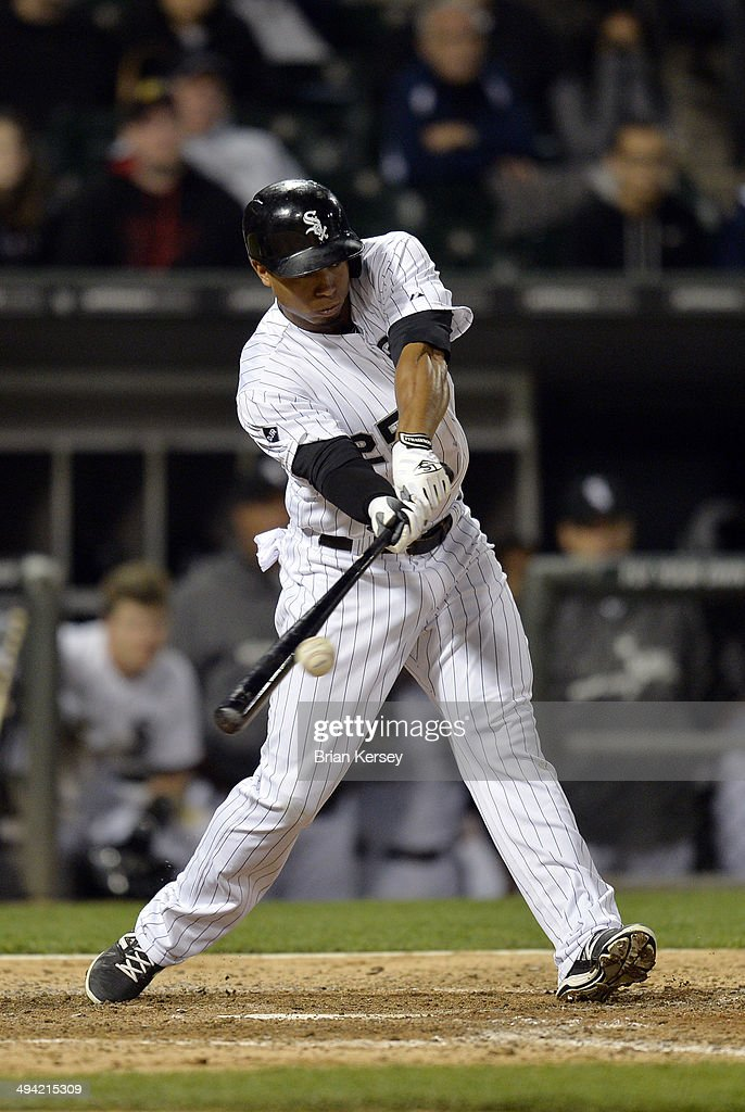 Moises Sierra #25 of the Chicago White Sox connects on a game-winning RBI single scoring Leury Garcia during the ninth inning against the Cleveland Indians at U.S. Cellular Field on May 28, 2014 in Chicago, Illinois. The White Sox defeated the Indians 3-2.