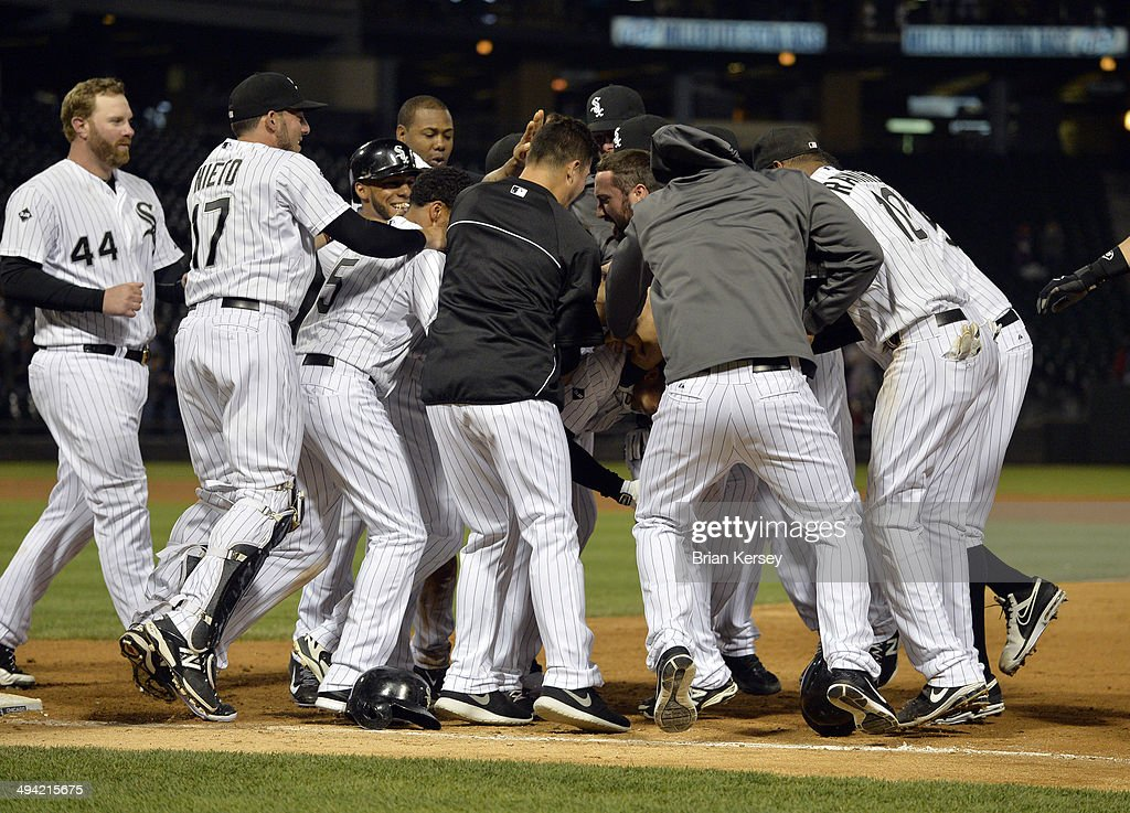 Moises Sierra #25 of the Chicago White Sox is mobbed by his teammates after hitting a game-winning RBI single scoring Leury Garcia during the ninth inning against the Cleveland Indians at U.S. Cellular Field on May 28, 2014 in Chicago, Illinois. The White Sox defeated the Indians 3-2.
