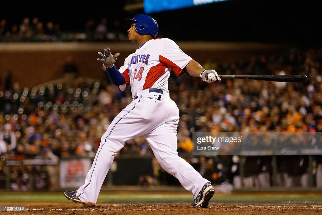 Moises Sierra #14 of the Dominican Republic hits an RBI double in the fifth inning against the Netherlands during the semifinal of the World Baseball Classic at AT&T Park on March 18, 2013 in San Francisco, California.