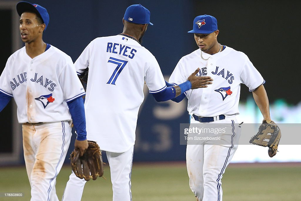 <a gi-track='captionPersonalityLinkClicked' href=/galleries/search?phrase=Moises+Sierra&family=editorial&specificpeople=7509137 ng-click='$event.stopPropagation()'>Moises Sierra</a> #14 of the Toronto Blue Jays celebrates their victory with Jose Reyes #7 during MLB game action against the New York Yankees on August 28, 2013 at Rogers Centre in Toronto, Ontario, Canada.