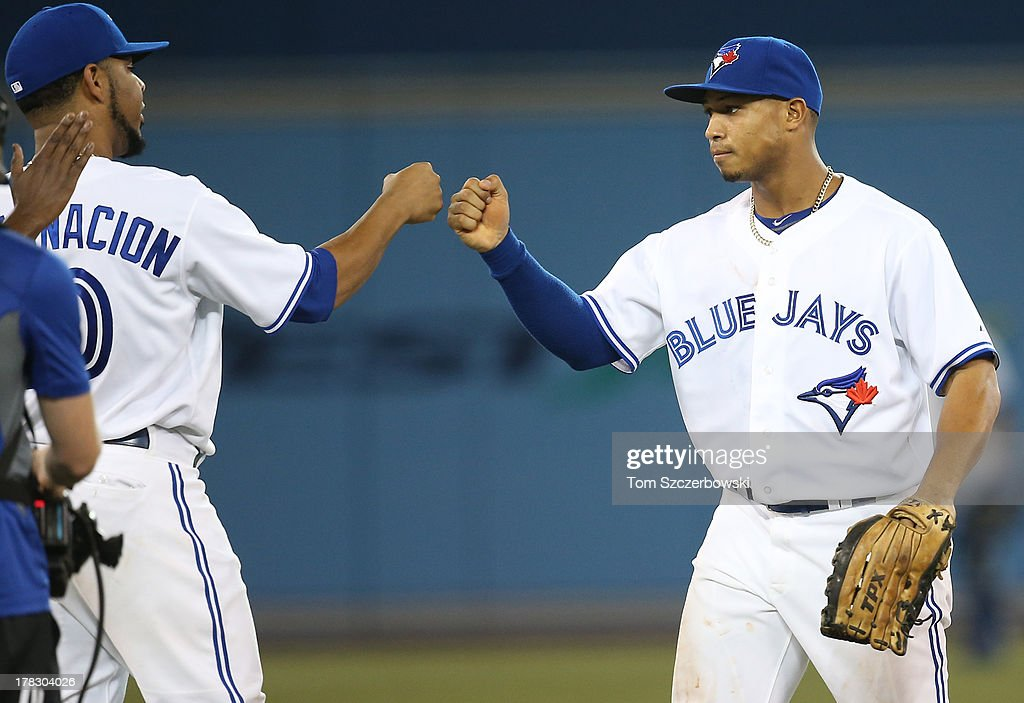 <a gi-track='captionPersonalityLinkClicked' href=/galleries/search?phrase=Moises+Sierra&family=editorial&specificpeople=7509137 ng-click='$event.stopPropagation()'>Moises Sierra</a> #14 of the Toronto Blue Jays celebrates their victory with <a gi-track='captionPersonalityLinkClicked' href=/galleries/search?phrase=Edwin+Encarnacion&family=editorial&specificpeople=598285 ng-click='$event.stopPropagation()'>Edwin Encarnacion</a> #10 during MLB game action against the New York Yankees on August 28, 2013 at Rogers Centre in Toronto, Ontario, Canada.