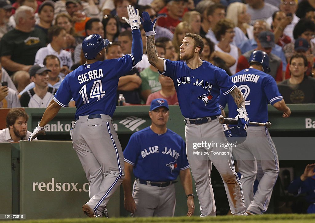 <a gi-track='captionPersonalityLinkClicked' href=/galleries/search?phrase=Moises+Sierra&family=editorial&specificpeople=7509137 ng-click='$event.stopPropagation()'>Moises Sierra</a> #14 of the Toronto Blue Jays is greeted by <a gi-track='captionPersonalityLinkClicked' href=/galleries/search?phrase=Brett+Lawrie&family=editorial&specificpeople=5496694 ng-click='$event.stopPropagation()'>Brett Lawrie</a> #13 of the Toronto Blue Jays after his two run home run against the Boston Red Sox as manager John Farrell #52 of the Toronto Blue Jays, center, looks on during the fourth inning of the game at Fenway Park on September 7, 2012 in Boston, Massachusetts.