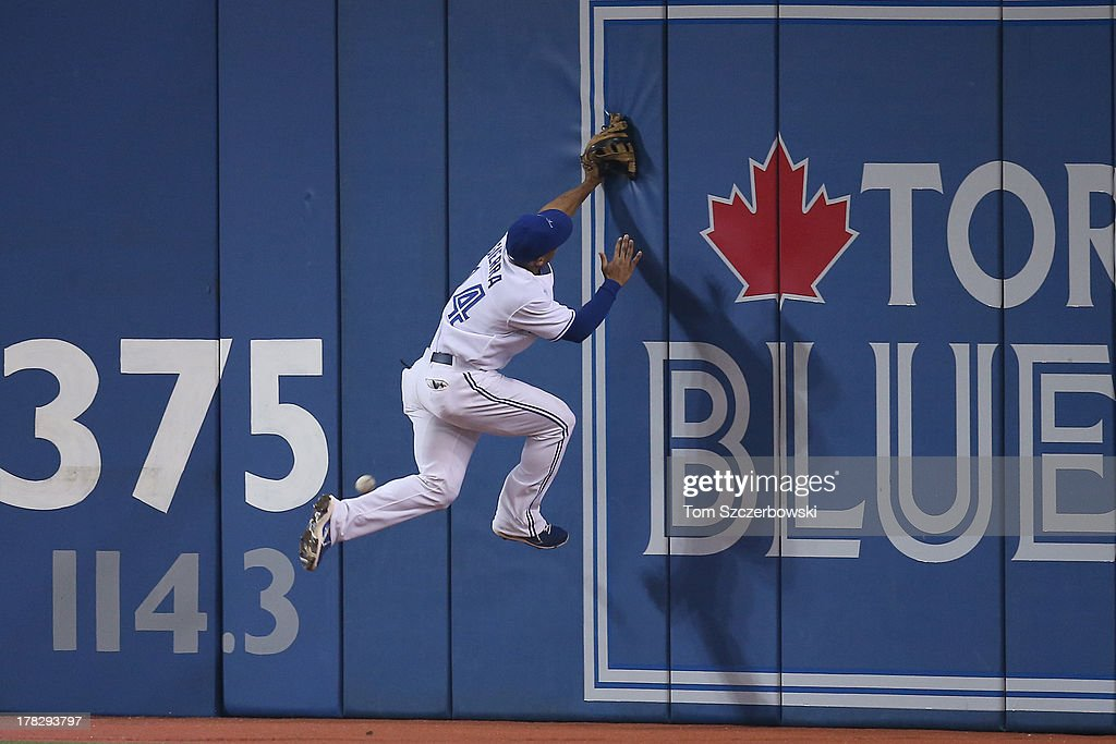 <a gi-track='captionPersonalityLinkClicked' href=/galleries/search?phrase=Moises+Sierra&family=editorial&specificpeople=7509137 ng-click='$event.stopPropagation()'>Moises Sierra</a> #14 of the Toronto Blue Jays leaps but cannot get to an RBI double by Mark Reynolds #39 of the New York Yankees in the fourth inning on August 28, 2013 at Rogers Centre in Toronto, Ontario, Canada.