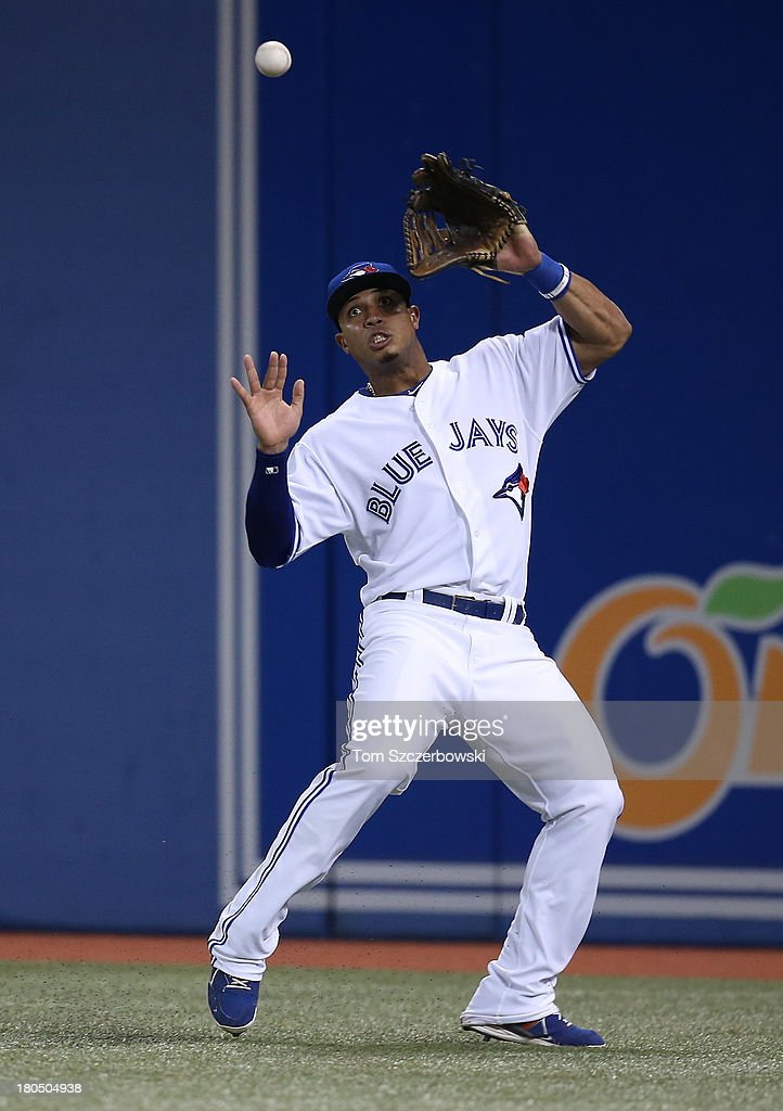<a gi-track='captionPersonalityLinkClicked' href=/galleries/search?phrase=Moises+Sierra&family=editorial&specificpeople=7509137 ng-click='$event.stopPropagation()'>Moises Sierra</a> #14 of the Toronto Blue Jays misplays a double in the seventh inning during MLB game action by Steve Clevenger #45 of the Baltimore Orioles on September 13, 2013 at Rogers Centre in Toronto, Ontario, Canada.