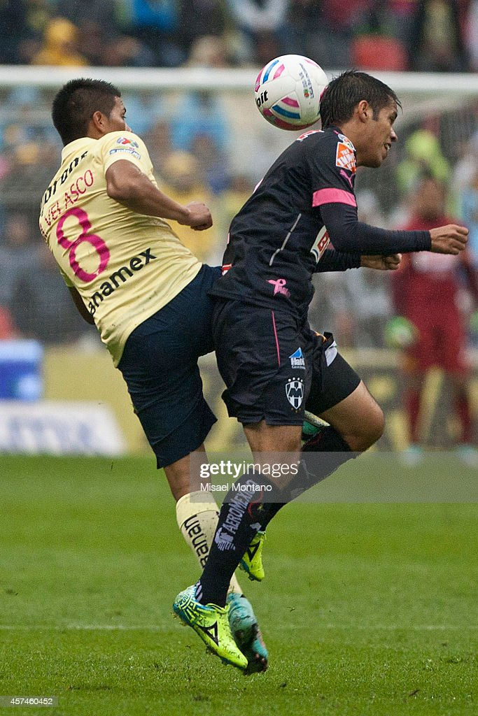 Moises Velasco of America fights for the ball with Severo Meza of Monterrey during a match between America and Monterrey as part of 13th round...