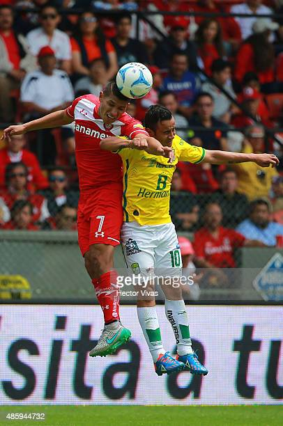 Moises Velasco of Toluca struggles for the ball with Luis Montes of Leon during a 7th round match between Toluca and Leon as part of the Apertura...