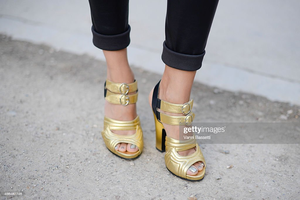 Mojeh Izadpanah poses wearing Prada shoes on the streets of Paris during Paris Fashion Week on October 1 2014 in Paris France